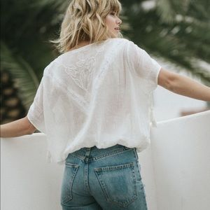 embroidered top w tassels on the sleeves
